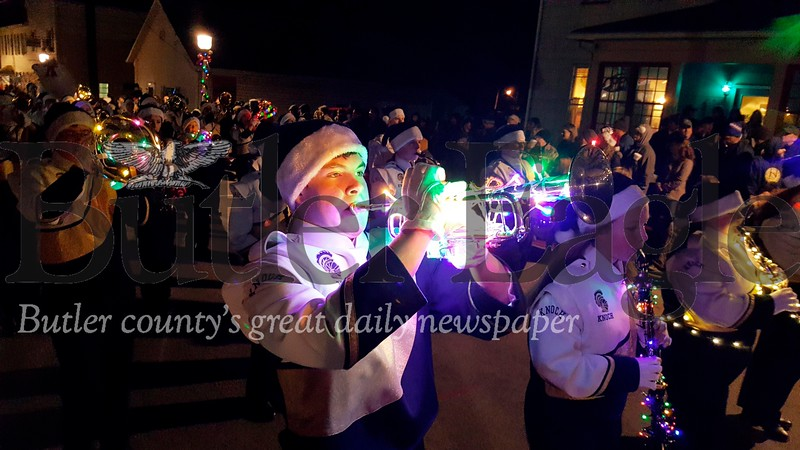 Harold Aughton/Special to the Eagle: Knoch's Brandon Sloan lights up the night with his trumpet during the Saxonburg parade.