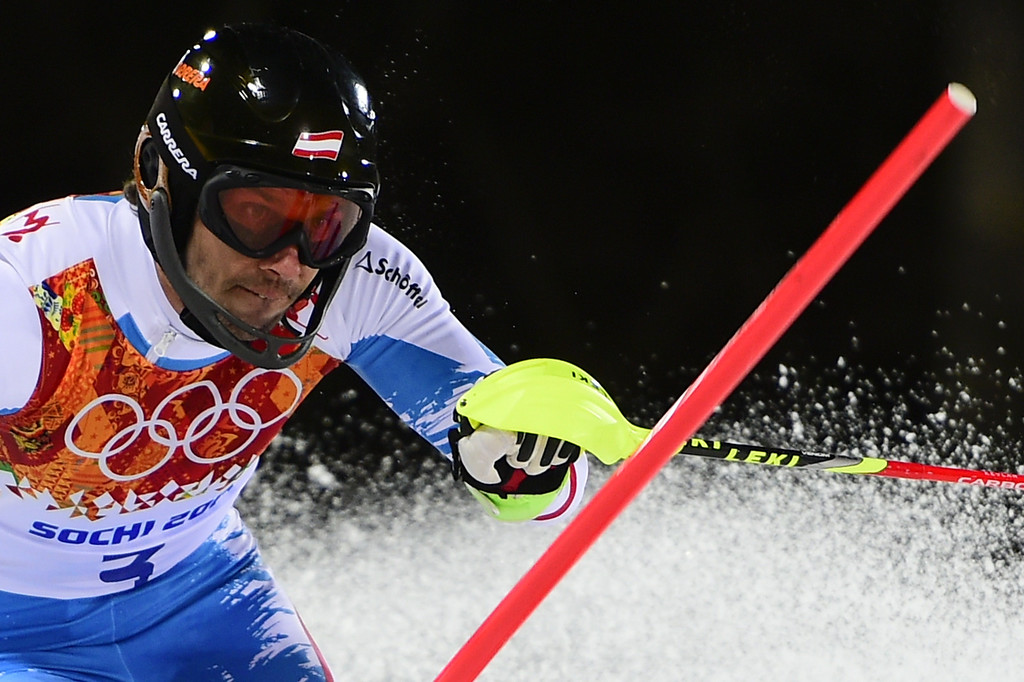 . Austria\'s Mario Matt clears a gate during the Men\'s Alpine Skiing Slalom Run 2 at the Rosa Khutor Alpine Center during the Sochi Winter Olympics on February 22, 2014.  FABRICE COFFRINI/AFP/Getty Images