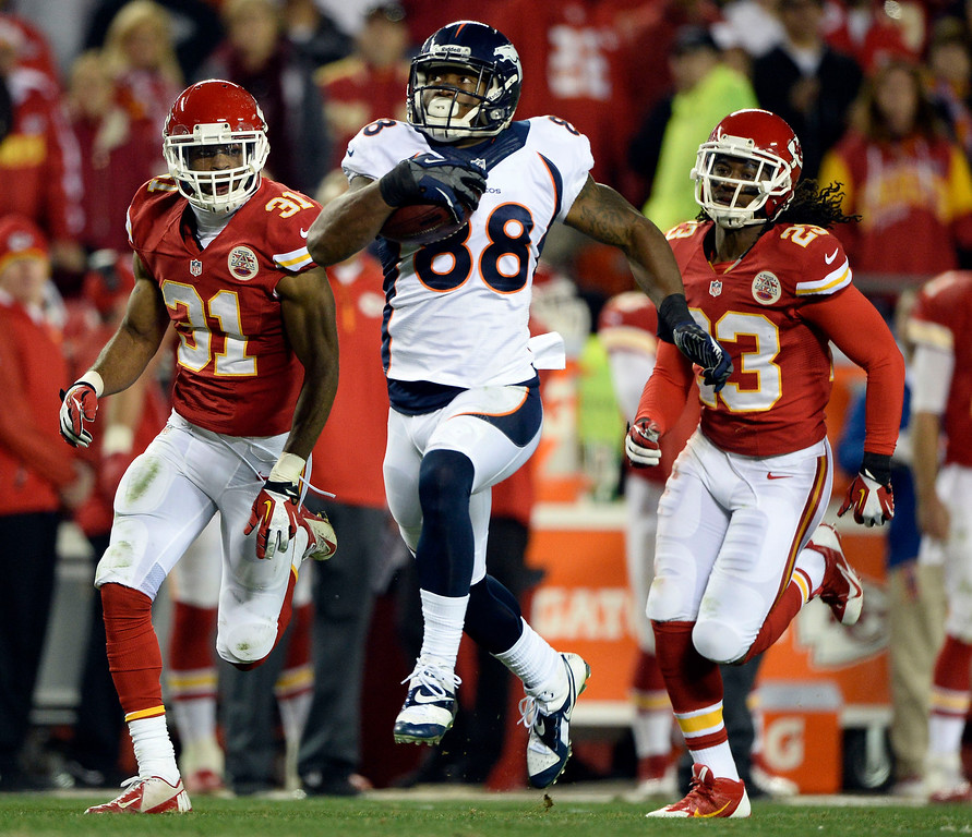. Denver Broncos wide receiver Demaryius Thomas (88) catches a pass on Kansas City Chiefs cornerback Marcus Cooper (31) along the Kansas City Chiefs sidelines and picks up 77 yards on the play during the third quarter December 1, 2013 at Arrowhead Stadium.  (Photo by John Leyba/The Denver Post)