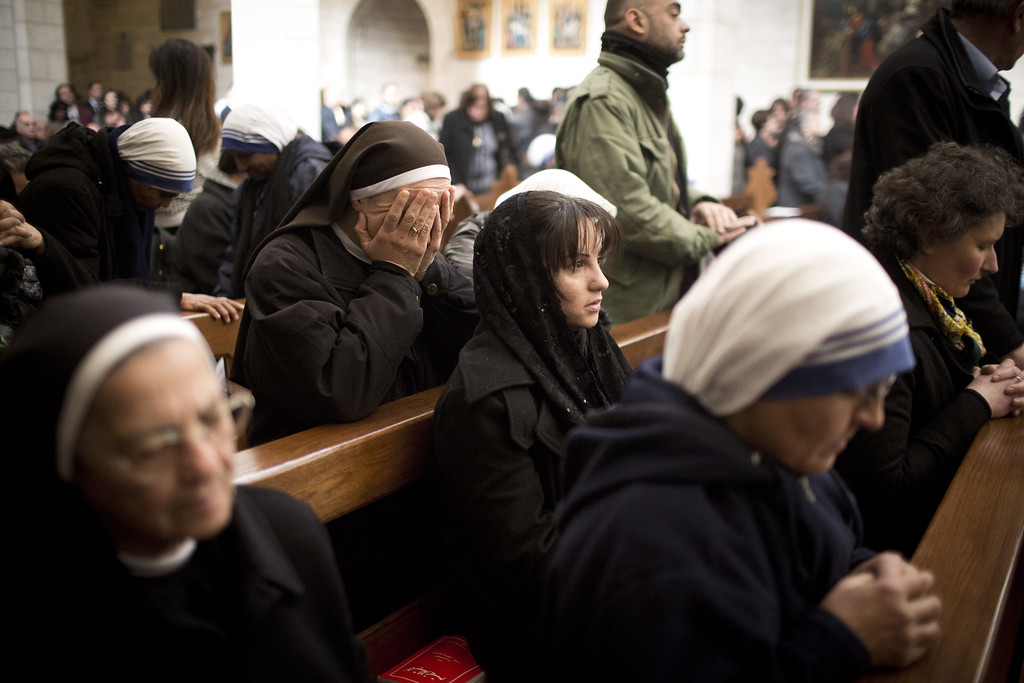 . BETHLEHEM, WEST BANK - DECEMBER 25: Christian nuns pray during the Christmas mass at the Church of the Nativity on December 25, 2013 in Bethlehem, West Bank. Every Christmas pilgrims travel to the church where a gold star embedded in the floor marks the spot where Jesus was believed to have been born. (Photo by Oren Ziv/Getty Images)