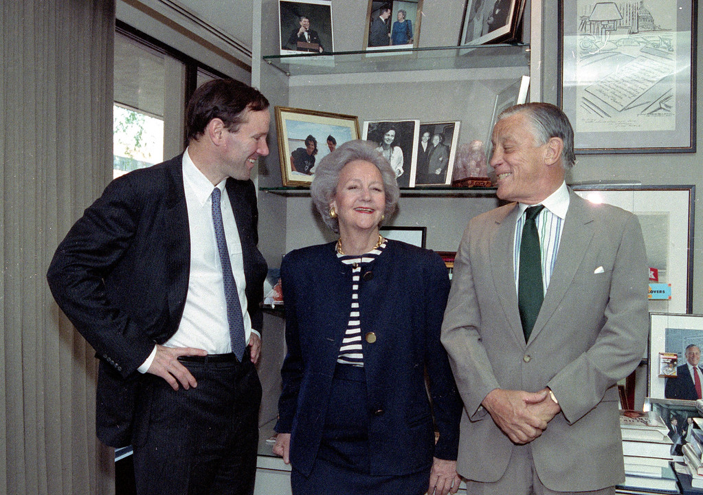 . FILE - In this Wednesday, May 8, 1991, file photo, Katharine Graham, Chairman of the Washington Post poses with her son publisher Donald Graham, left, and Ben Bradlee, executive editor of the post, in her office in New York City. (AP Photo/Dennis Cook, File)