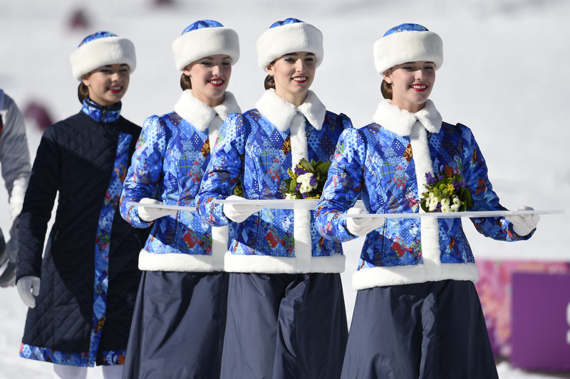 . Volunteers bring flowers for the flower ceremony after the Women\'s Cross-Country Skiing 7,5km + 7,5km Skiathlon at the Laura Cross-Country Ski and Biathlon Center during the Sochi Winter Olympics on February 8, 2014 in Rosa Khutor.  (ODD ANDERSEN/AFP/Getty Images)