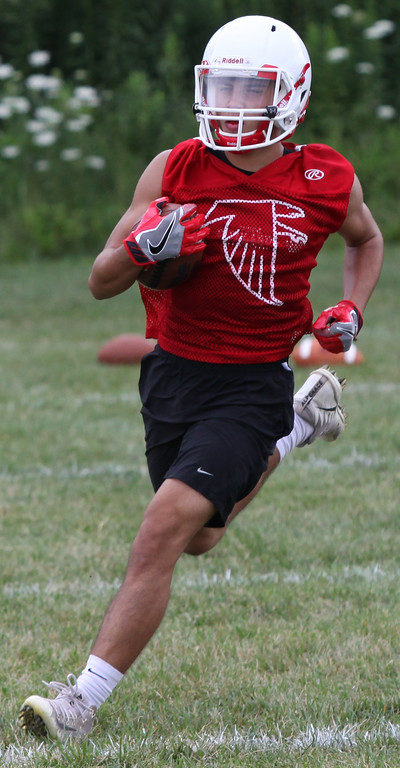 . Randy Meyers - The Morning Journal<br> A Firelands running back takes part in the offensive drills during Firelands\' first football practice on July 30.