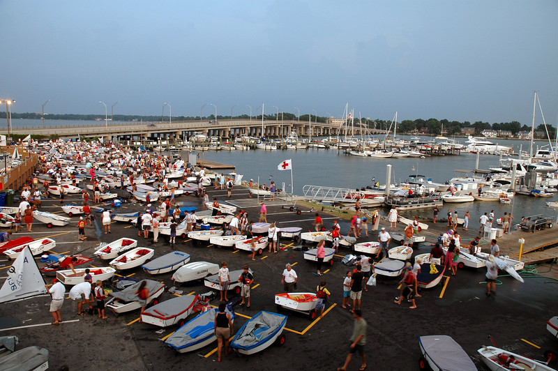 Opti sailors secure their boats as inclimate weather approaches.