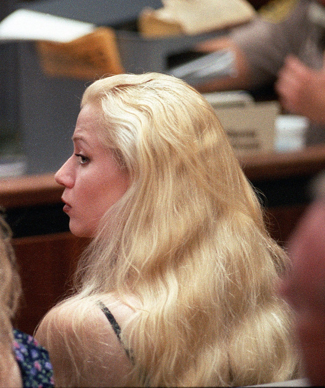 . File - Anna Eriksson, the fiancee of Lyle Menendez, watches as Lyle and his brother Erik are sentenced in a courtroom in the Van Nuys section of Los Angeles Tuesday, July 2, 1996. The brothers were sentenced to two consecutive life sentences. Judge Stanley Weisberg did not address Lyle\'s request to marry Eriksson, a longtime pen pal. (AP Photo/Pool,Sam Mircovich)