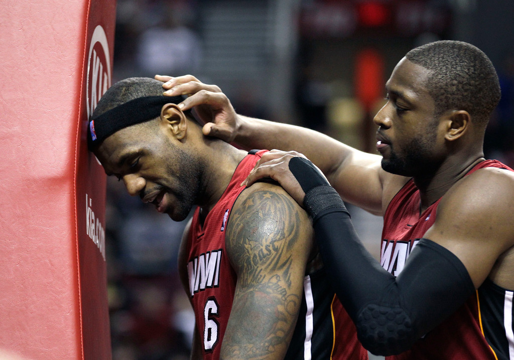 . Miami Heat\'s Dwyane Wade, right, talks with Miami Heat\'s LeBron James (6) after he missed a shot in the first half during their  NBA basketball game with the Portland Trail Blazers Sunday, Jan. 9, 2011, in Portland, Ore.  (AP Photo/Rick Bowmer)