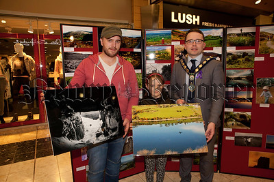 Mayor Daire Hughes is pictured with the winners of the Ring of Gullion Photography competition, Ciaran McDonald and under 14's winner Aoibh Tomany. R1448007