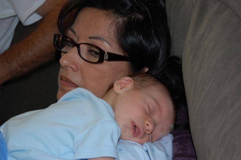 Elliot snuggling with Grandma Barbara