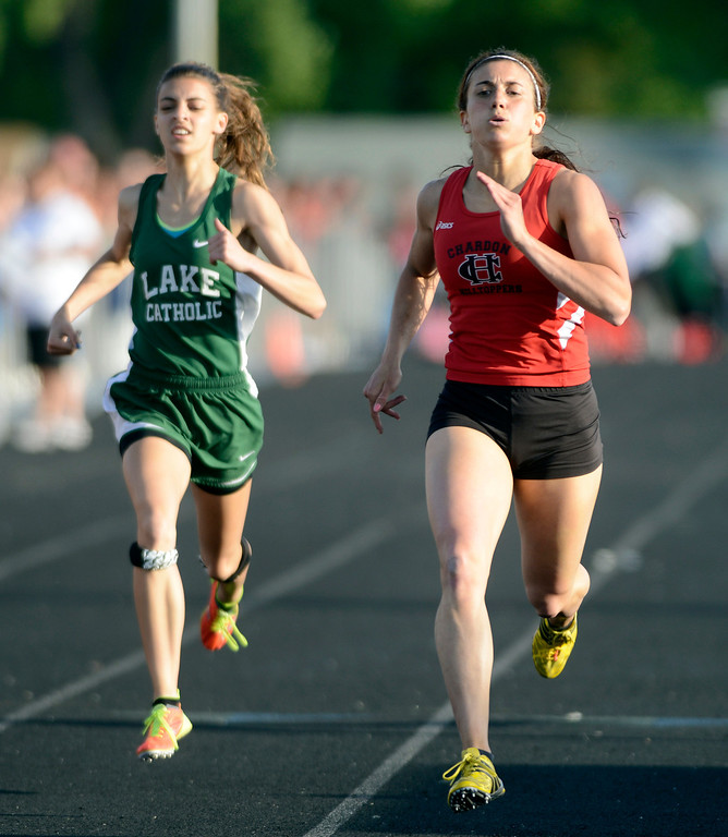 . Maribeth Joeright/MJoeright@News-Herald.com<p> Chardon\'s Stephanie Ferrante finishes first and Lake Catholic\'s Frances Bull takes third in the girls 400 meter dash during the Divison I regional final meet.