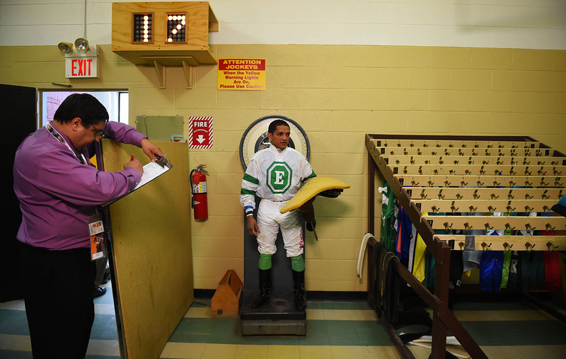 . A jockey is weighed before a race prior to the 139th running of the Preakness Stakes at Pimlico Race Course on May 17, 2014 in Baltimore, Maryland.  (Photo by Patrick Smith/Getty Images)