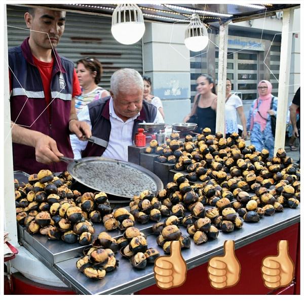 men selling chestnuts on street
