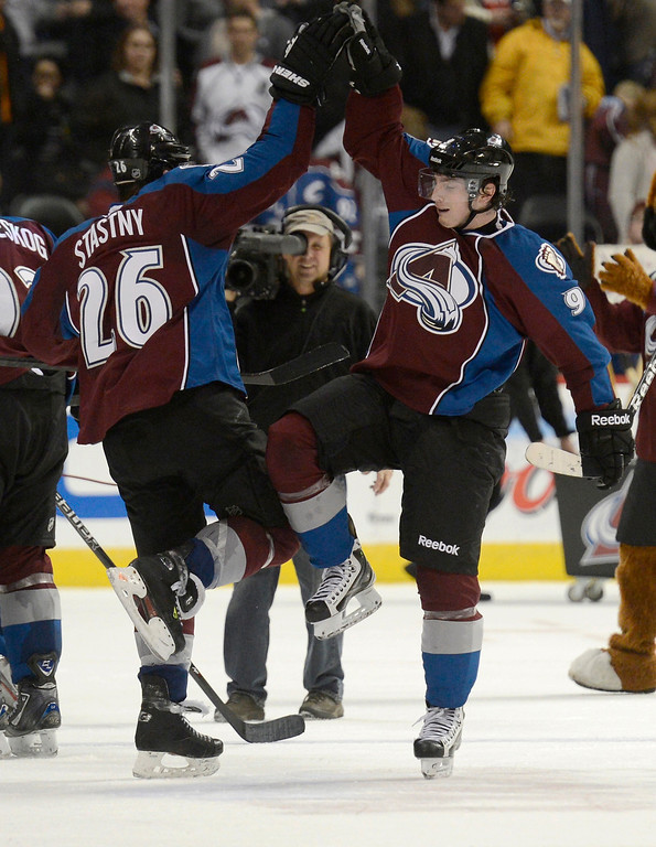 . DENVER, CO. - FEBRUARY 28: Paul Stastny (26) of the Colorado Avalanche high fives Matt Duchene (9) of the Colorado Avalanche at the end of the game against the Calgary Flames  February 28, 2013 at Pepsi Center. The Colorado Avalanche defeated the Calgary Flames 5-4.(Photo By John Leyba/The Denver Post)