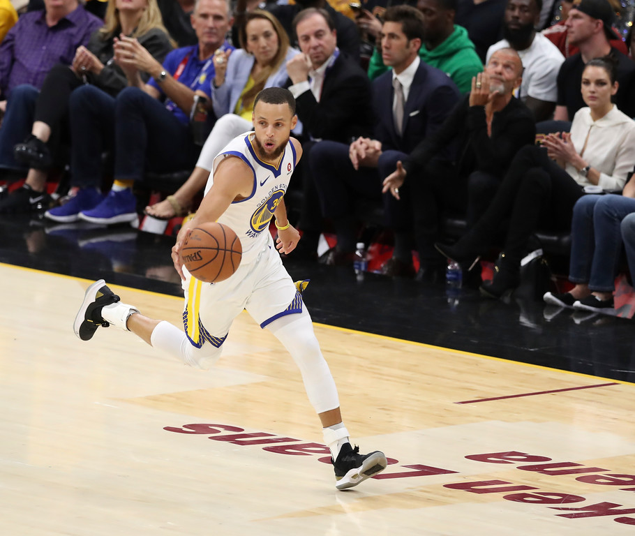 . Golden State Warriors\' Stephen Curry dribbles in the second half of Game 3 of basketball\'s NBA Finals against the Cleveland Cavaliers, Wednesday, June 6, 2018, in Cleveland. The Warriors defeated the Cavaliers 110-102 to take a 3-0 lead in the series. (AP Photo/Carlos Osorio)