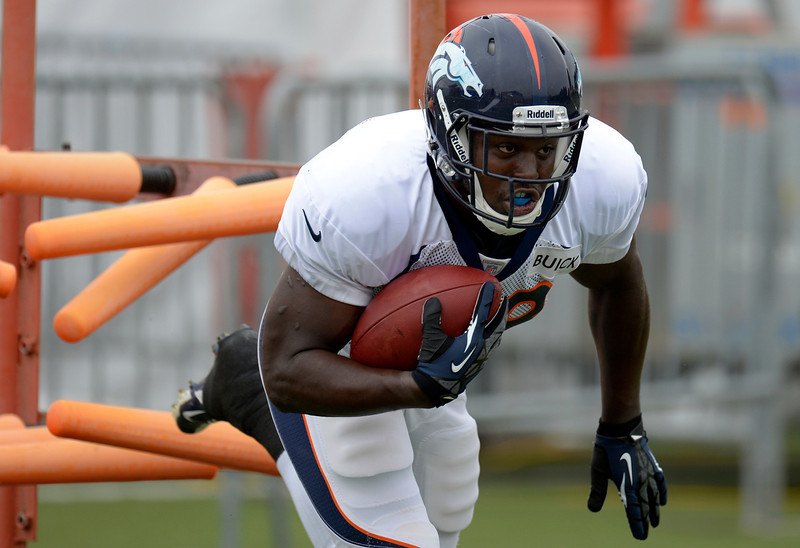 . Denver Broncos RB Montee Ball (38) runs through drills during training camp July 29, 2013 at Dove Valley. (Photo By John Leyba/The Denver Post)