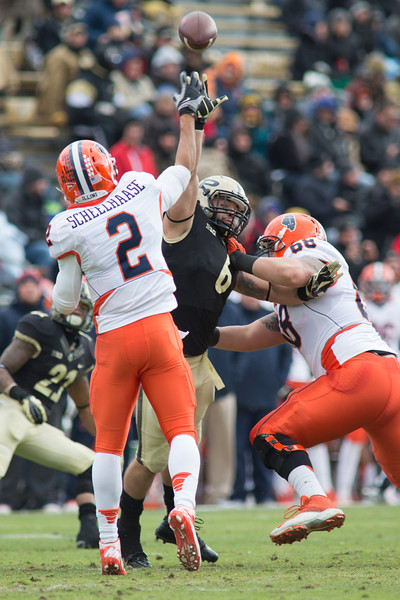 Nathan Schellhaase (2) throws over Ruben Ibarra (6) of Purdue