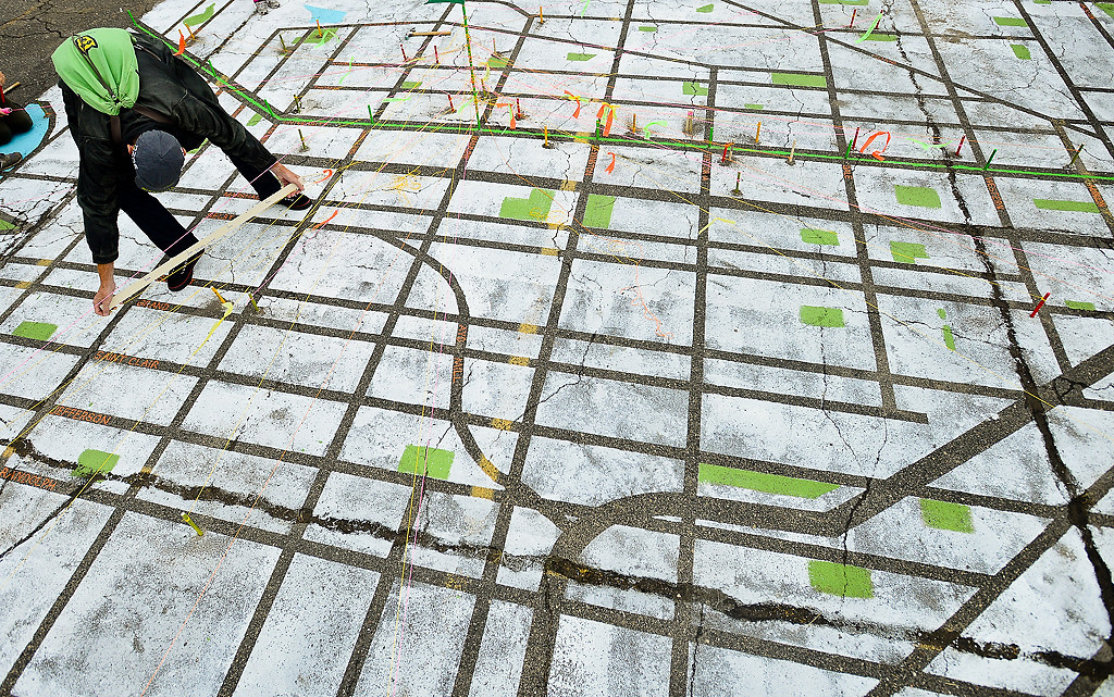""". Tony Desnick of St. Paul estimates the distance to his neighborhood on an art piece titled \""""Mapping the Ave.\"""" (Pioneer Press: Ben Garvin)"""