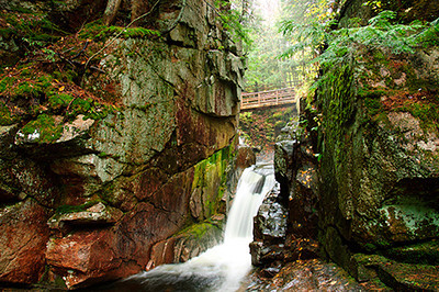 Footbridge across one tier of Sabbaday Falls In new Hampshire.