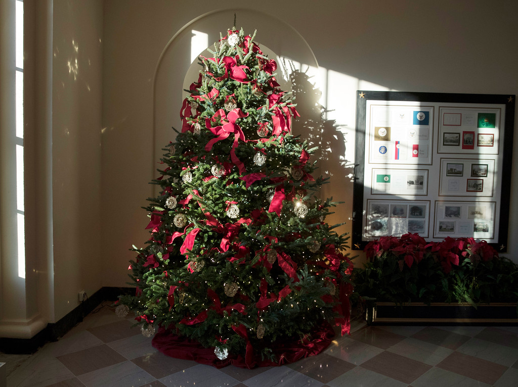 . A Christmas tree is seen in the the East Garden Room during a media preview of the 2017 holiday decorations at the White House in Washington, Monday, Nov. 27, 2017. (AP Photo/Carolyn Kaster)