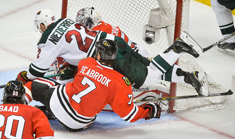 . Minnesota Wild right wing Nino Niederreiter dives after the pick over Chicago Blackhawks goalie Corey Crawford and in front of Brent Seabrook (7) during the third period. (Pioneer Press: Ben Garvin)