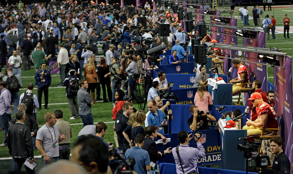 . Members of the San Francisco 49ers football team are interviewed by reporters during media day for the NFL Super Bowl XLVII football game Tuesday, Jan. 29, 2013, in New Orleans. (AP Photo/Mark Humphrey)