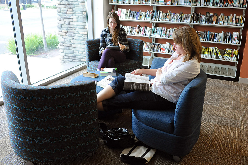 . Janet Linahan and her daughter Kelly spend an afternoon in a reading lounge area at the Old Town Newhall Library November 12, 2103.  Libraries have evolved into more comfortable places that cater to digital reading habits, with computers and more public meeting spaces.(Andy Holzman/Los Angeles Daily News)