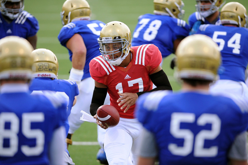 . UCLA quarterback Brett Hundley hands off the ball during practice April 9, 2014 in Westwood, CA.(Andy Holzman/Los Angeles Daily News)