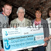 Gabby Curran's son Piaras, along with Eileen King and Ann O'Brien, who performed at Gabby's Showband Spectacular, present a cheque for £750 to Marie Graham of The Southern Area Hospice. On the same night Gabby's All Stars also presented cheques for £1500 and £750 to Marie Curie and MacMillan Cancer Support. A total of £3000 was raised for the cancer charities.