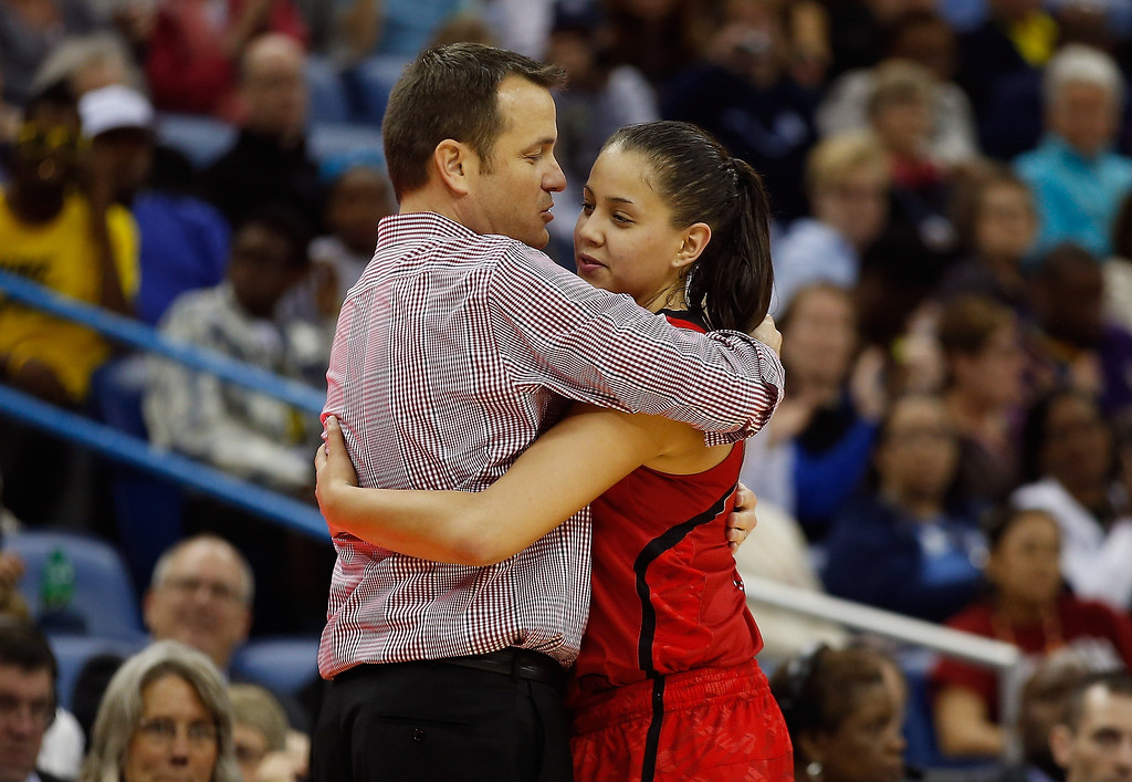 . Head coach Jeff Walz of the Louisville Cardinals hugs Shoni Schimmel #23 as she comes out of the game against the Connecticut Huskies during the 2013 NCAA Women\'s Final Four Championship at New Orleans Arena on April 9, 2013 in New Orleans, Louisiana.  (Photo by Chris Graythen/Getty Images)