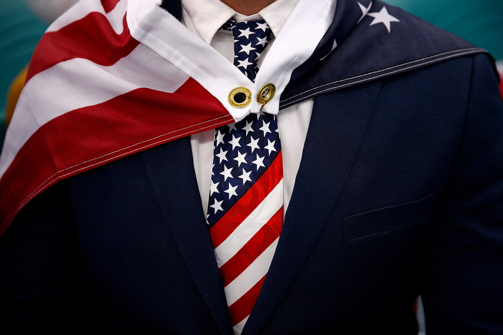 . Patrick Kearney wears an American flag as a cape during the quarterfinal round of the men\'s hockey game between the United States and the Czech Republic at the 2018 Winter Olympics in Gangneung, South Korea, Wednesday, Feb. 21, 2018. (AP Photo/Jae C. Hong)