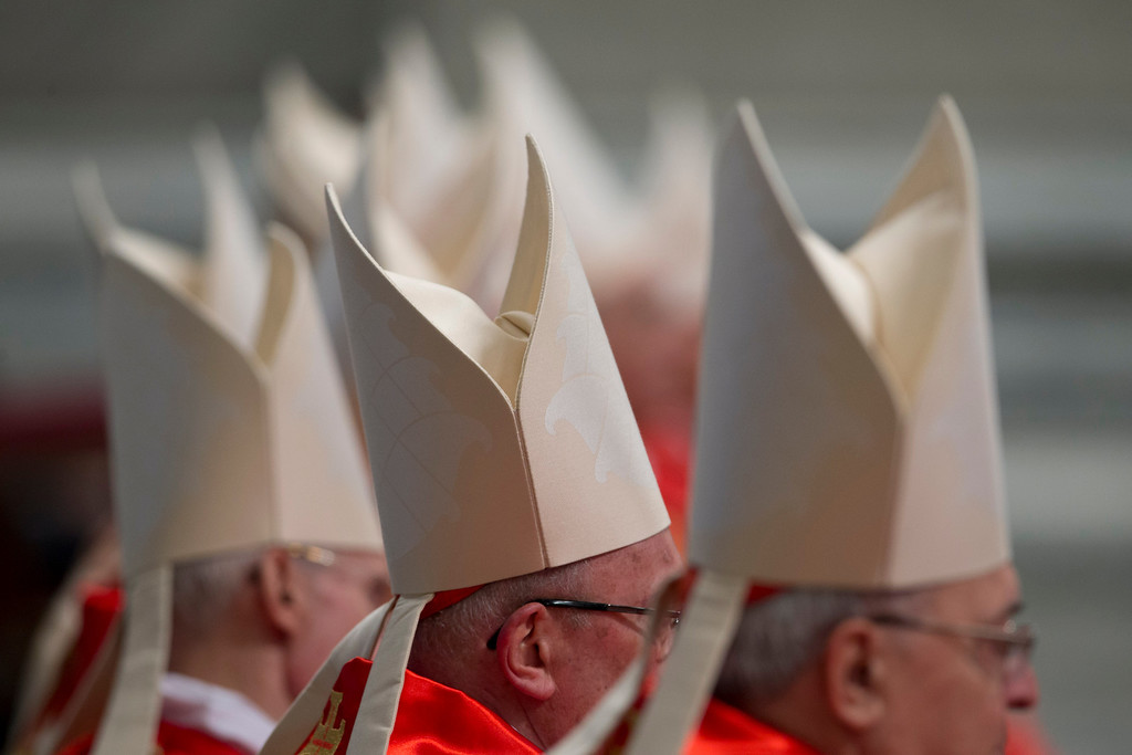 . Cardinals attend a Mass for the election of a new pope celebrated by Cardinal Angelo Sodano inside St. Peter\'s Basilica, at the Vatican, Tuesday, March 12, 2013.  (AP Photo/Andrew Medichini)