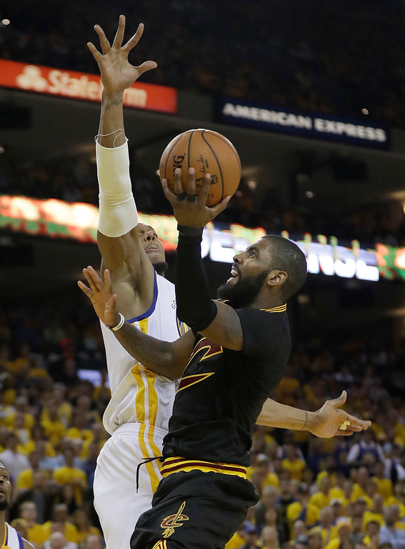 . Cleveland Cavaliers guard Kyrie Irving, right, shoots against Golden State Warriors forward David West during the second half of Game 2 of basketball\'s NBA Finals in Oakland, Calif., Sunday, June 4, 2017. (AP Photo/Marcio Jose Sanchez)