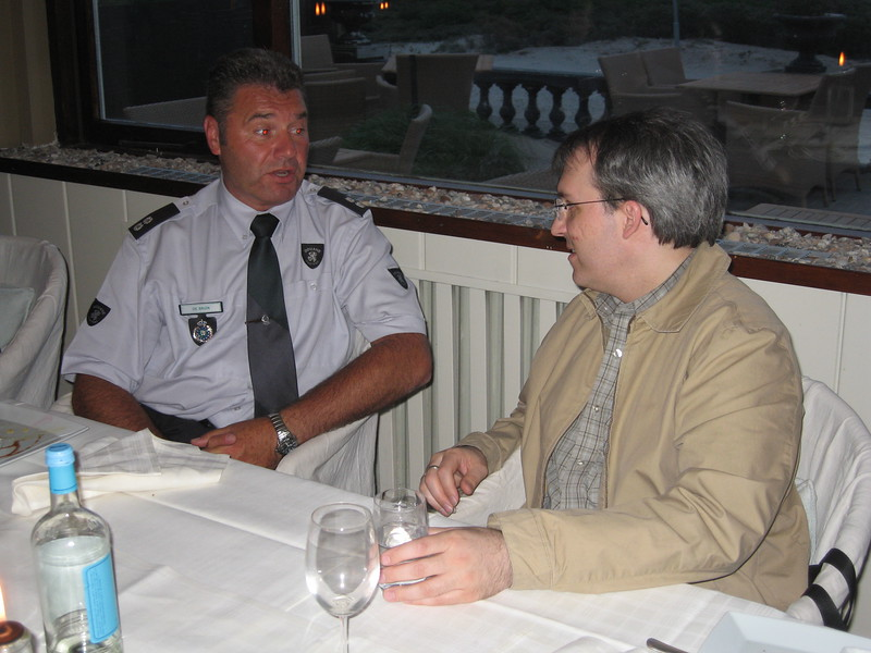 A Dutch Customs officer chats with Paul at Restaurant Sand in Hoek van Holland