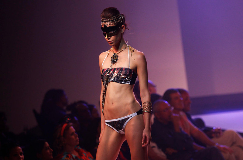 . A model presents a creation during Colombo Fashion Week in Colombo April 3, 2013. REUTERS/Dinuka Liyanawatte