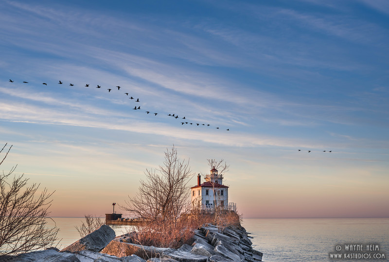 Flying over Fairport Lighthouse     Photography by Wayne Heim