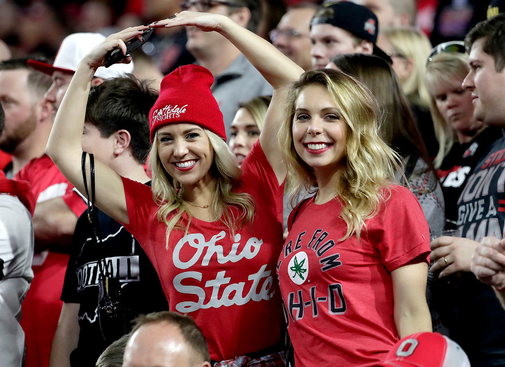 . Ohio State fans cheer during the first half of the Fiesta Bowl NCAA college football game against Clemson, Saturday, Dec. 31, 2016, in Glendale, Ariz. (AP Photo/Rick Scuteri)