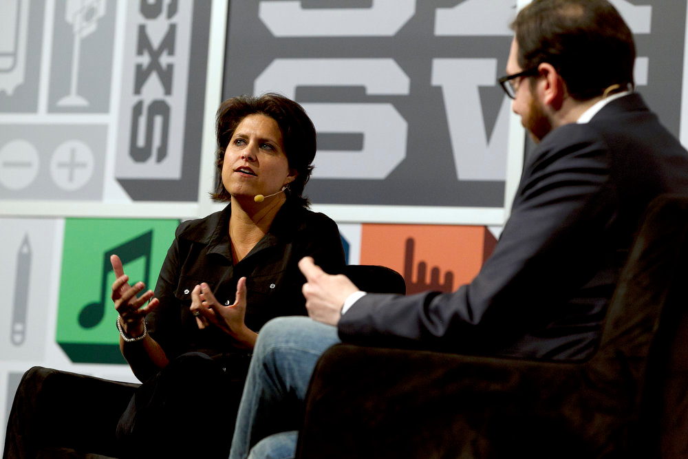 . Ouya Founder and CEO Julie Uhrman talks with Josh Topolsky during the SXSW Interactive Festival in Austin, Texas, on Monday, March 11, 2013. (AP Photo/American-Statesman, Deborah Cannon)