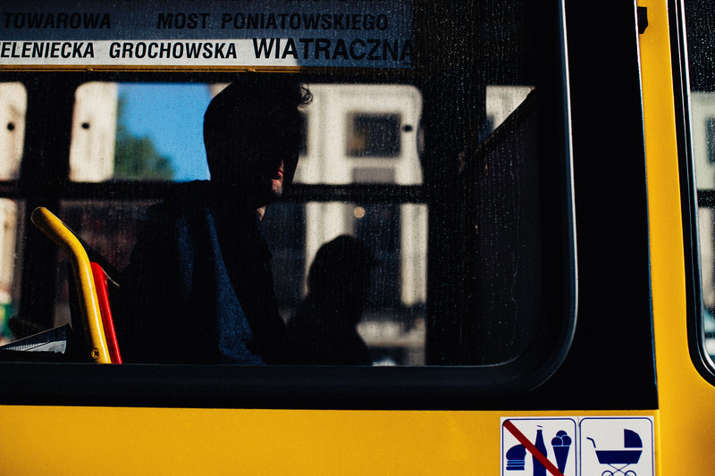 side view of tram man in shadow light on face.jpg
