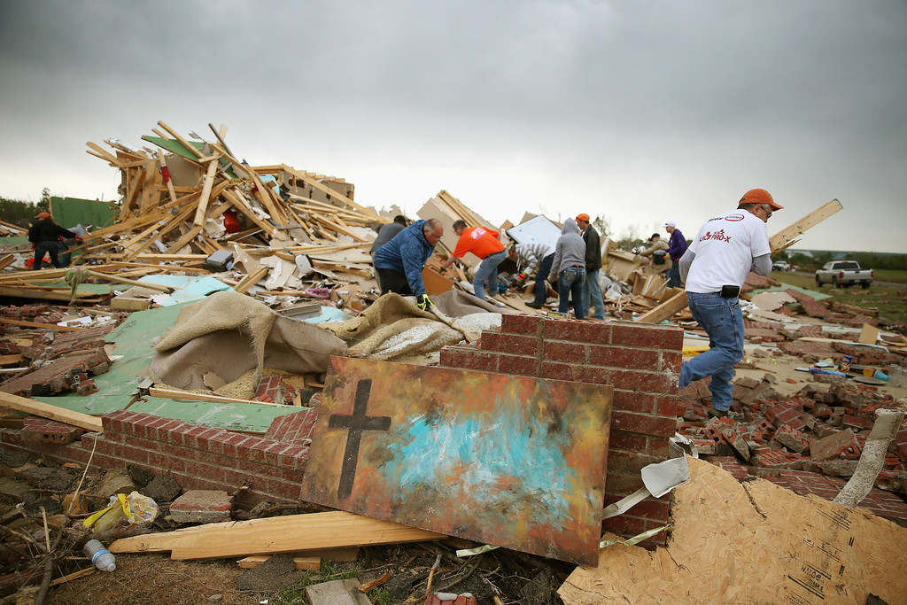 . Volunteers help clean debris at the site of a home that was detroyed after a tornado hit the area April 29, 2014 in Vilonia, Arkansas.  (Photo by Mark Wilson/Getty Images)