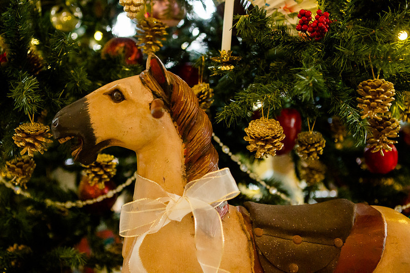 . An antique horse has pride of place at the base of a Christmas tree at the Governor\'s Residence at Boettcher Mansion. Photo by Mark Broste