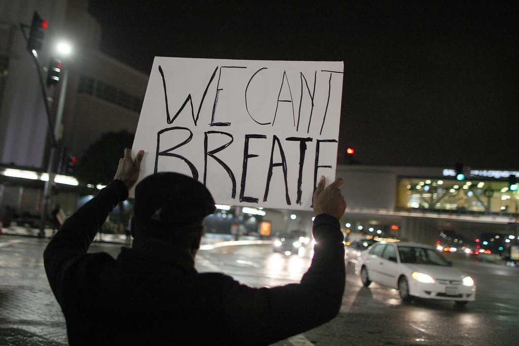 . Protesters march in response to the decision by a New York grand jury not to indict a police officer involved in the chokehold death of Eric Garner on December 3, 2014 in Los Angeles, California. The decision follows a similar ruling last week in which white Ferguson, Missouri police officer Darren Wilson was not indicted in the shooting death of unarmed black teenager Michael Brown. Those protests resulted in hundreds of arrests in Los Angeles.   (Photo by David McNew/Getty Images)