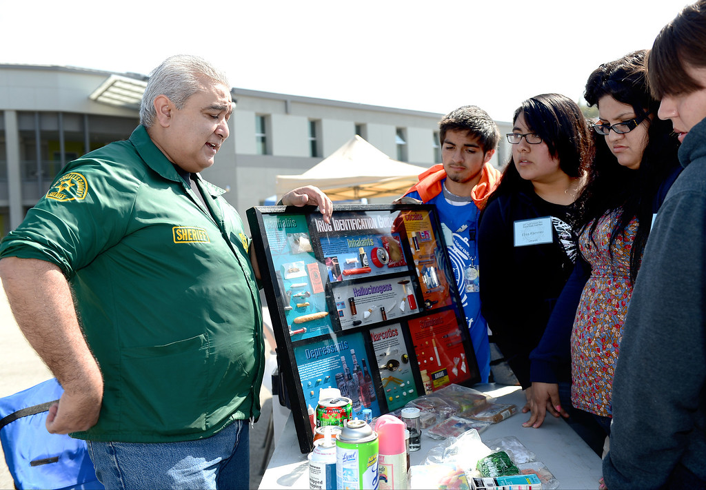 . Drug prevention deputy Armando Alvarado, of the Los Angeles County Sheriff\'s Department, educates youth on the dangers of drugs, alcohol and household items that people are getting high on during the 4th Annual San Gabriel Youth Summit at Columbia School in El Monte Saturday, March 23, 2013. (SGVN/Staff Photo by Sarah Reingewirtz)