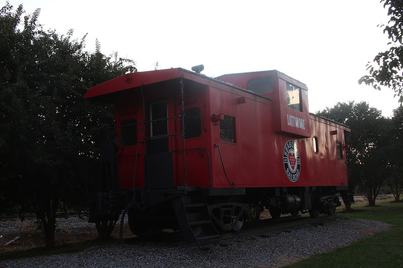 Dr. Bob Carey takes his photo class toLightpaint the Lattimore Caboose. This is the reference photo without any light painting.