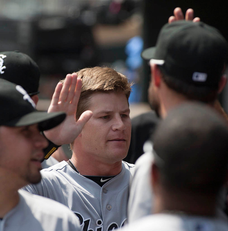 . Chicago White Sox Gordon Beckham, center, is congratulated by teammates after scoring from second on an Alexei Ramirez single during the first inning. (AP Photo/Paul Battaglia)