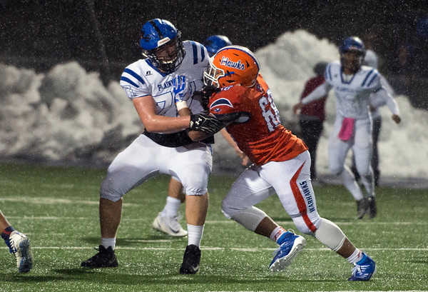12/09/19 Wesley Bunnell | StaffrrPlainville football was defeated by Bloomfield in a CIAC playoff game on a rainy Monday night at Bloomfield High School. DL Ryan Barker (77).