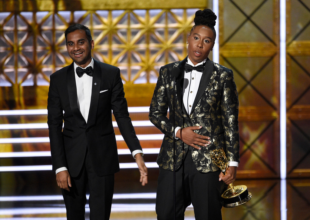 ". Aziz Ansari, left, and Lena Waithe accept the award for outstanding writing for a comedy series for the ""Master of None\"" episode \""Thanksgiving\"" at the 69th Primetime Emmy Awards on Sunday, Sept. 17, 2017, at the Microsoft Theater in Los Angeles. (Photo by Chris Pizzello/Invision/AP)"