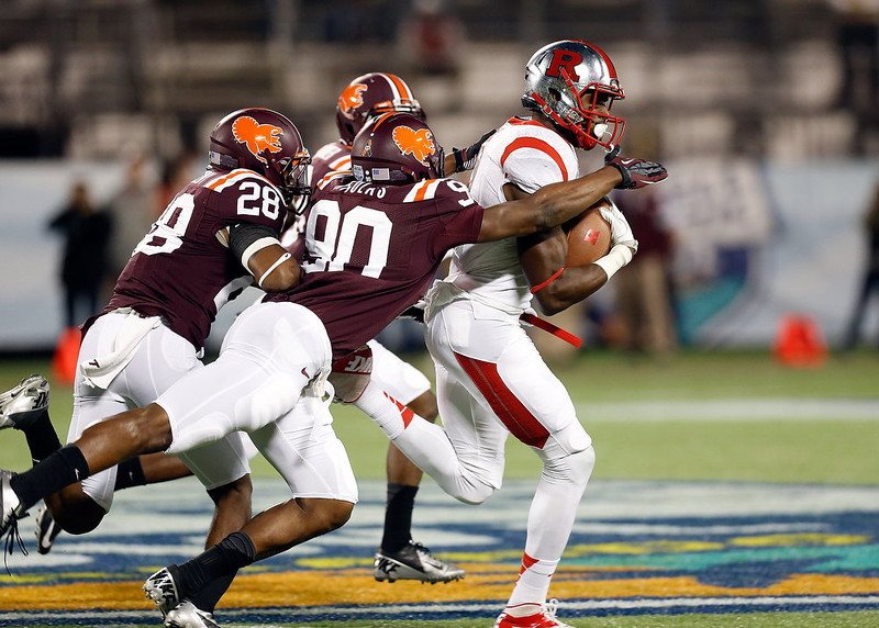 . Defensive end Dadi Nicolas #90 of the Virginia Tech Hokies tackles receiver Brandon Coleman #17 of the Rutgers Scarlet Knights during the Russell Athletic Bowl Game at the Florida Citrus Bowl on December 28, 2012 in Orlando, Florida.  (Photo by J. Meric/Getty Images)