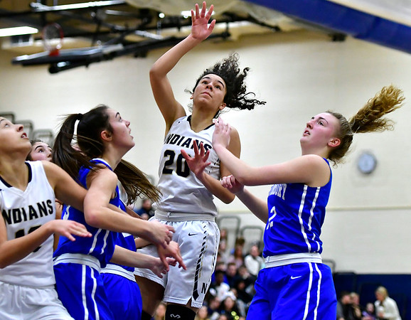 3/1/2019 Mike Orazzi | Staff Newington High School's Olivia St. Remy (20) and Glastonbury Tomahawks' Chelsea Tacey (12) during the Class LL Second Round of the CIAC 2019 State Girls Basketball Tournament at Newington High School Friday night.