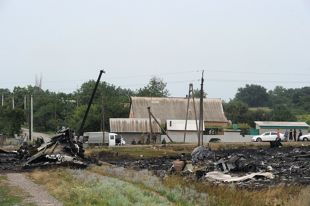 . A picture taken on July 18, 2014 shows the wreckages of the Malaysia Airlines jet carrying 298 people from Amsterdam to Kuala Lumpur a day after it crashed, near the town of Shaktarsk, in rebel-held east Ukraine. Pro-Russian separatists in the region and officials in Kiev blamed each other for the crash, after the plane was apparently hit by a surface-to-air missile. All 298 people on board Flight MH17 died when the plane crashed. Rescue workers at the crash site said that they had found one of the black boxes from the passenger liner. AFP PHOTO/DOMINIQUE FAGET/AFP/Getty Images