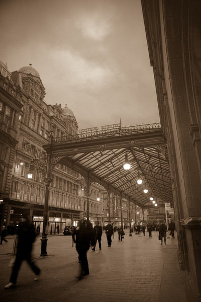 A shot in rush hour at the front front of Glasgow Central Station.  It's the sepia version of the HDR posted earlier.  My family liked this version the best.