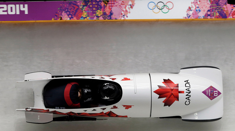 . The team from Canada CAN-1, piloted Kaillie Humphries with brakeman Heather Moyse, take a curve during the women\'s two-man bobsled competition at the 2014 Winter Olympics, Tuesday, Feb. 18, 2014, in Krasnaya Polyana, Russia. (AP Photo/Michael Sohn)
